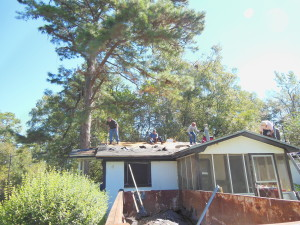 United Church of Tallahassee volunteers work on Vivian Cromartie's roof on a cold morning in November